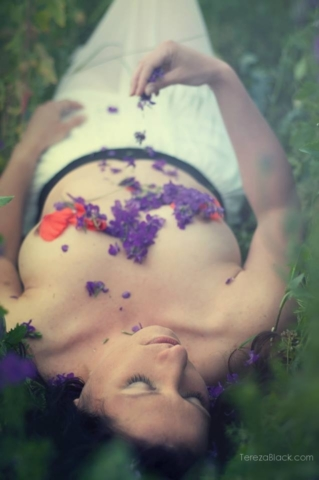 Naked girl covered by flowers