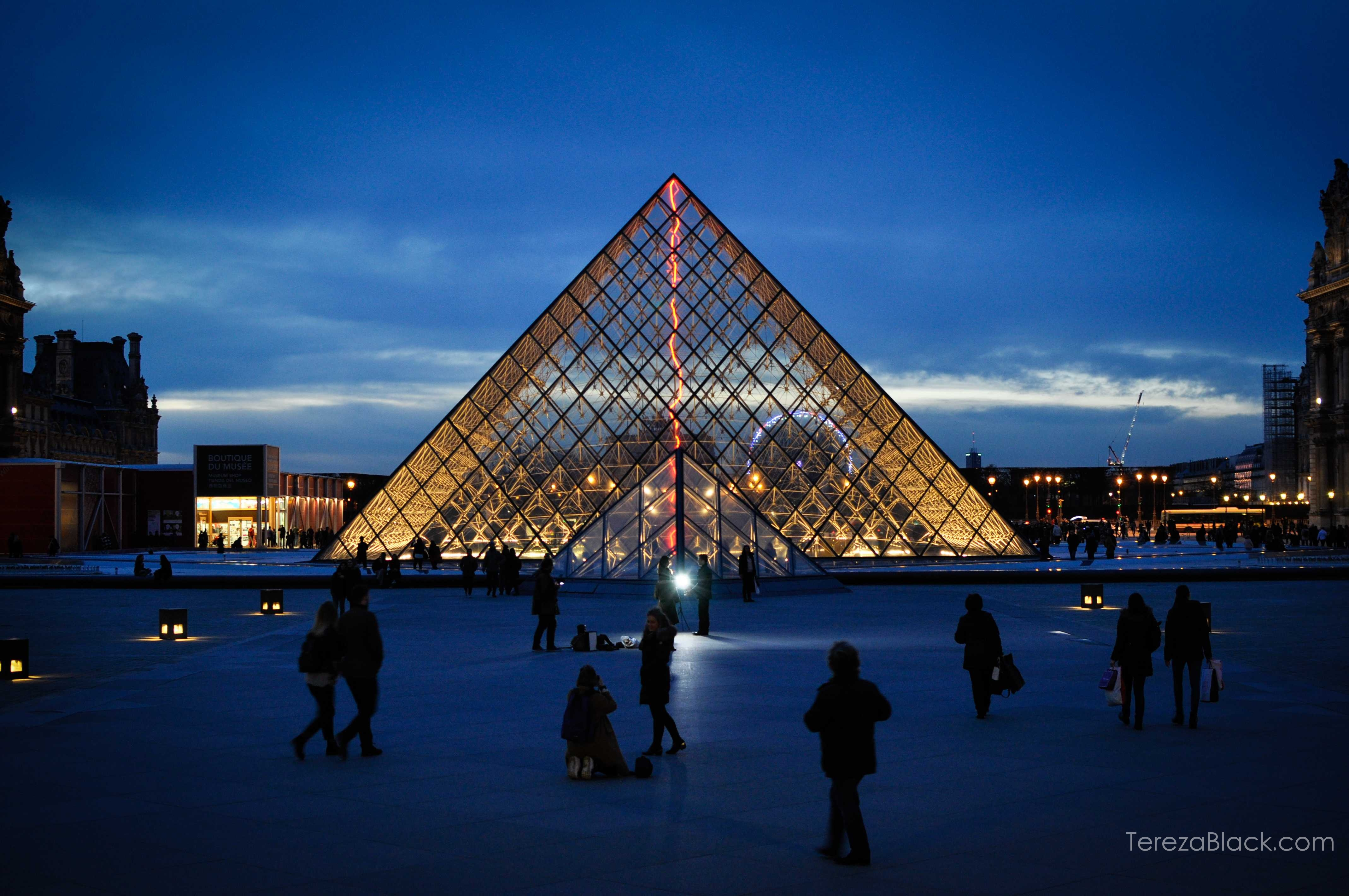 Pyramides of Louvre in Paris by night