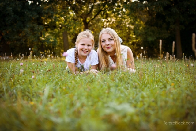 Sisters portrait in the green grass